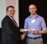 Dr David Joss with the first prize winner, Sergio Mauri
